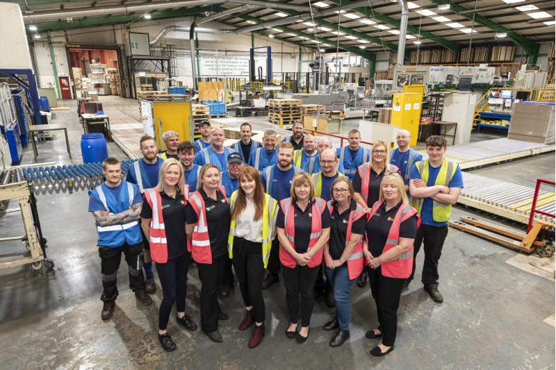 Team photo in factory