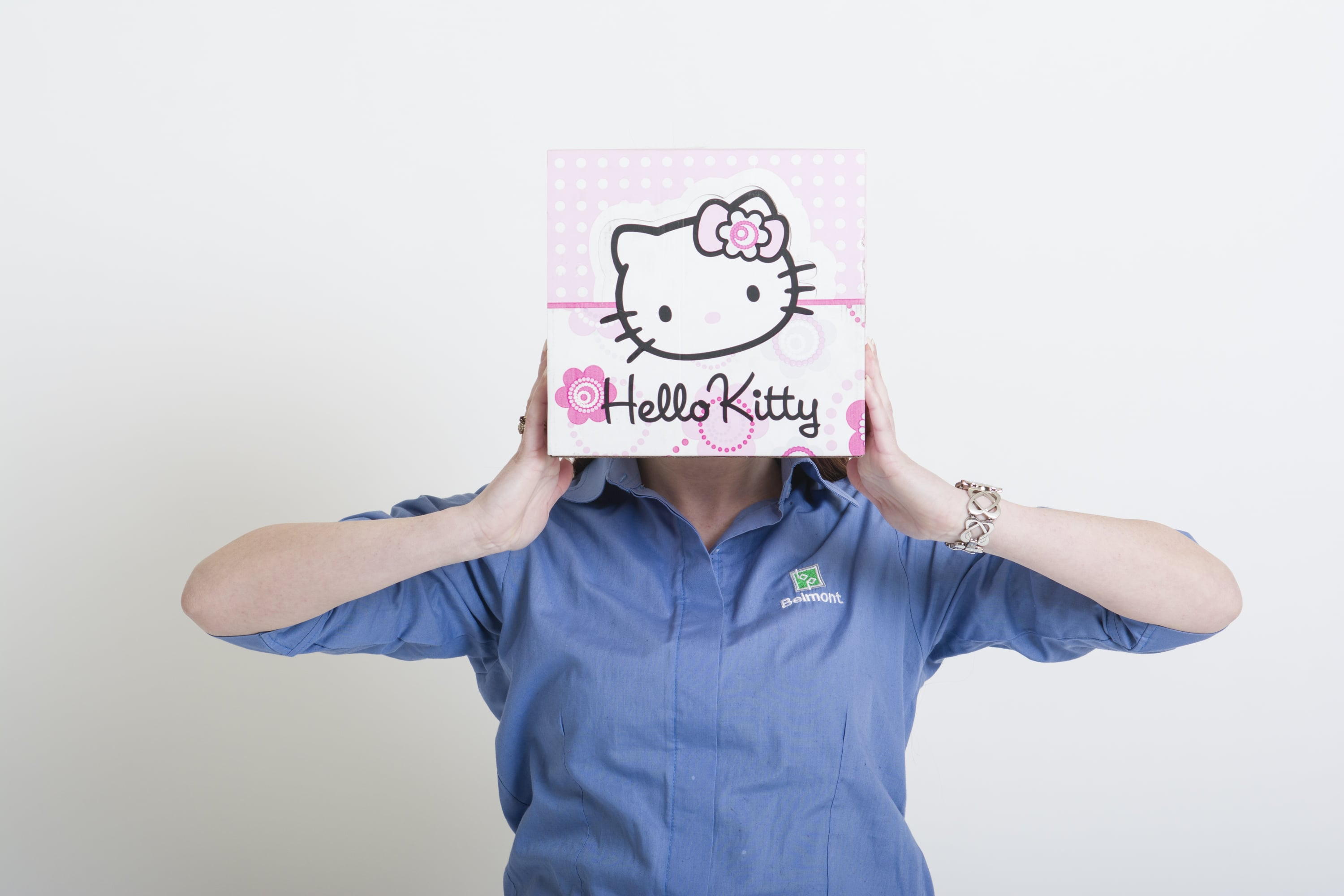 Hello Kitty branded and printed box held by Belmont staff member